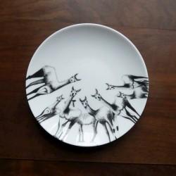 White porcelain plate guanacos