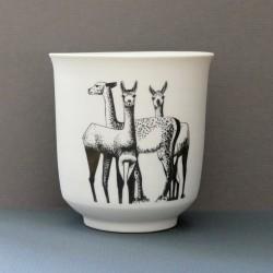 White porcelain cup guanacos